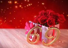 Birthday concept with red roses in gift on wooden desk.  Stock Photo