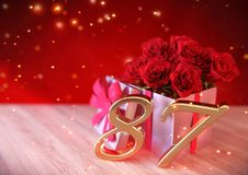 Birthday concept with red roses in gift on wooden desk. eighty-seventh. 87th. 3D render. Birthday concept with red roses in gift on wooden desk. 3D render Royalty Free Stock Photo