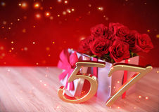 Birthday concept with red roses in gift on wooden desk. fifty-seventh. 57th. 3D render. Birthday concept with red roses in gift on wooden desk. 3D render - fifty Royalty Free Stock Photography