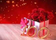 Birthday concept with red roses in gift on wooden desk. hundredth. 100th. 3D render. Birthday concept with red roses in gift on wooden desk. 3D render Stock Photo
