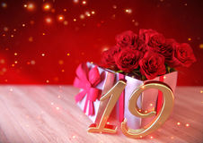 Birthday concept with red roses in the gift on wooden desk. nineteenth. 19th. 3D render. Birthday concept with red roses in the gift on wooden desk. 3D render Stock Photography
