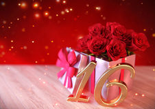 Birthday concept with red roses in gift on wooden desk. sixteenth. 16th. 3D render Stock Photo