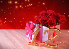Birthday concept with red roses in gift on wooden desk 12th. 3D render Royalty Free Stock Photos