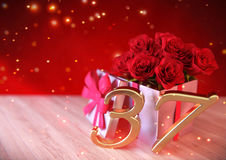 Birthday concept with red roses in the gift on wooden desk. thirty-seventh. 37th. 3D render. Birthday concept with red roses in the gift on wooden desk. 3D Royalty Free Stock Photography
