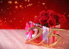 Birthday concept with red roses in the gift on wooden desk. twentyfifth. 25th. 3D render. Birthday concept with red roses in the gift on wooden desk. 3D render Stock Image