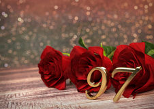 Birthday concept with red roses on wooden desk. ninety-seventh. 97th. 3D render. Birthday concept with red roses on wooden desk. 3D render - ninety-seventh Royalty Free Stock Images