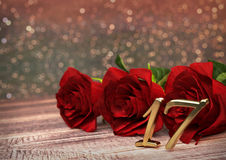 Birthday concept with red roses on wooden desk. seventeenth. 17th. 3D render Royalty Free Stock Photography