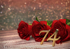Birthday concept with red roses on wooden desk. seventy-fourth. 74rd. 3D render Stock Image