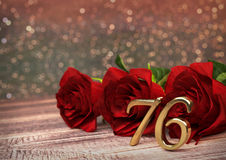 Birthday concept with red roses on wooden desk. seventy-sixth. 76th. 3D render Royalty Free Stock Photography