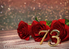 Birthday concept with red roses on wooden desk. seventy-third. 73rd. 3D render Royalty Free Stock Photography
