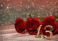 Birthday concept with red roses on wooden desk. thirteenth. 13th. 3D render. Birthday concept with red roses on wooden desk. 3D render - thirteenth birthday Royalty Free Stock Image