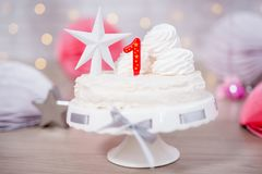 Birthday concept - sweet cake with one candle. First birthday concept - sweet cake with one candle stock image