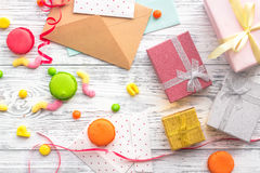 Birthday concept with wrapped gifts, greeting cards and sweets on grey wooden background top view Stock Image