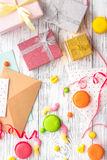 Birthday concept with wrapped gifts, greeting cards and sweets on grey wooden background top view Stock Photography
