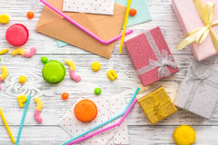 Birthday concept with wrapped gifts, greeting cards and sweets on grey wooden background top view Royalty Free Stock Image