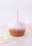 Birthday Cup Cake with Candle Stock Image