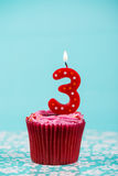 Birthday cup cake with number three Stock Photos