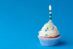 Birthday cupcake. Blue birthday cupcake with copy space at the side Royalty Free Stock Photo
