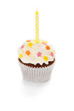 Birthday cupcake. Cupcake with cream icing and birthday candle on white background Stock Photos