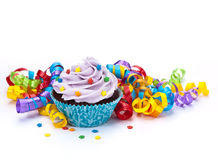 Birthday Cupcake. With colorful sprinkles and ribbons on a white background. Great for Birthday Parties stock photo