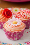 Birthday cupcake. Bright colored birthday cupcake decorated with flower made of sugar Stock Photo