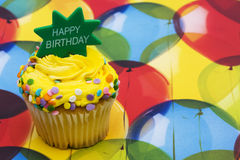 Birthday Cupcake. With a  balloon background ? celebration time Royalty Free Stock Photography