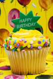 Birthday Cupcake. With balloon background- celebration time Stock Images