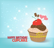 Birthday cupcake against a cyan background Royalty Free Stock Images