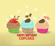 Birthday cupcake against a cyan background. Birthday cupcakes against a cyan background Stock Photography
