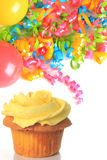 Birthday cupcake with balloons and ribbons. Stock Image