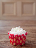 Birthday cupcake blurry background candle lit Stock Photography
