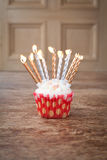 Birthday cupcake blurry background with lots of lit candles Royalty Free Stock Photo