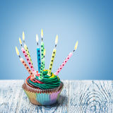 Birthday cupcake with burning candles Royalty Free Stock Images