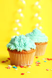 Birthday cupcake with butter cream on yellow background Royalty Free Stock Photos