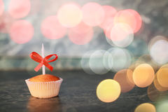 Birthday cupcake with a candle bokeh Stock Photos