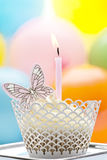 Birthday cupcake with candle and butterfly Stock Photography