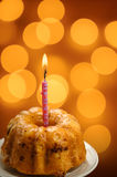 Birthday cupcake with candle Stock Photos