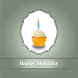 Birthday cupcake with candle and polka dots backgr Stock Images
