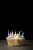Birthday Cupcake with Candles Blown Out Royalty Free Stock Photos