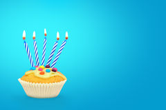 Birthday cupcake and candles Stock Photos