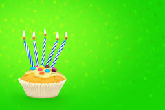 Birthday cupcake with candles and confetti Stock Photo