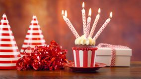 Birthday cupcake with candles and gift Stock Photography