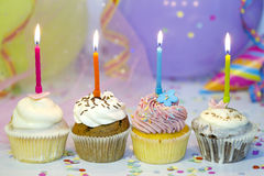 Birthday cupcake closeup on colorful background Royalty Free Stock Photography