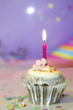 Birthday cupcake closeup on colorful background Royalty Free Stock Photo