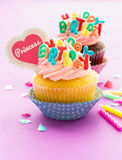 Birthday Cupcake. S on pink background Stock Image