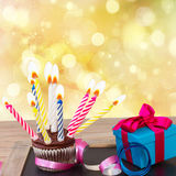 Birthday cupcake with gift box Royalty Free Stock Photos