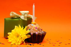 Birthday cupcake, gift and flower Stock Photography