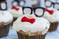 Birthday Cupcake. With Glasses And Red Bow Tie Royalty Free Stock Images