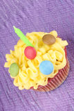 Birthday cupcake with green candle Stock Photos