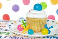 Birthday cupcake with gumballs Stock Photos